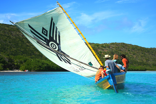 The Carib Indian Canoe Gli Gli goes out for a sail. Photo by Julian Putley