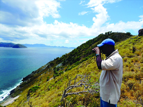 Ronald Massicott of National Parks Trust completes a bird survey at Tobagos