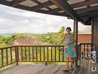Tina Goschler stands on the balcony of a Guavaberry cottage.