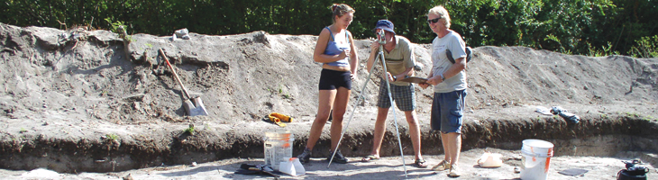 Dr.Peter Drewett and students unearth the ball court stones at Belmont
