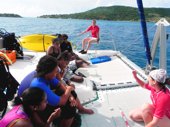 JVD students watch as SeaTrek staffer Angie Cowan gives a pre dive lesson on coral coverage monitoring