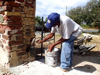 Man working on the St. Philips church at Kingstown Photo by Daniel Mejia