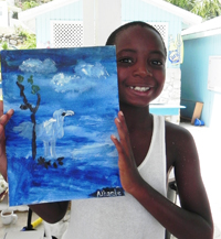 JVD kid holding a picture inspired by wildlife