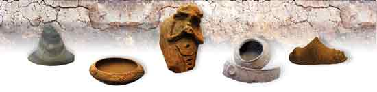 Taino artefacts including a stone and clay zemis; incised pottery and an adorno.