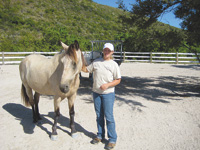 Torey Knoll, the resort's equestrian trainer with a porto fino.
