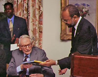 Laurance Rockefeller (seated left) and Michael O'Neal, JR O'Neal's son and then chairman of the National Park's Trust, at a ceremony bestowing belonger status on Mr. Rockefeller in 2003.