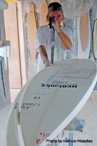 Bob Carson shapes a board in his workshop