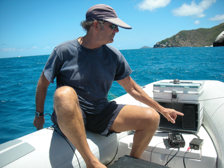 Paul Knapp adjusts the levels on his hydrophone equipment.
